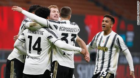 Juventus' McKennie celebrates with teammates after scoring his side's third goal against AC Milan.