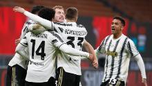 Juventus' McKennie celebrates with teammates after scoring his side's third goal against AC Milan.