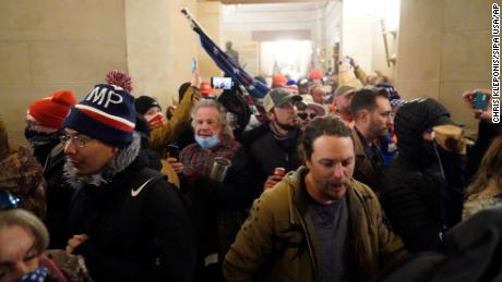 A mob storms the Capitol building on Wednesday, January 6, 2021.