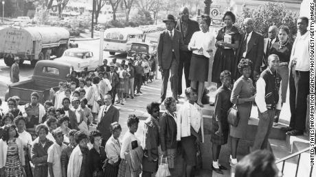 People wait to register to vote in Macon, Georgia, in 1962. Voting rights were denied many African Americans until 1965.