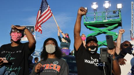 Supporters attend a campaign rally for Democratic Senate candidates Jon Ossoff and Rev. Raphael Warnock on January 4, 2021 -- the day before their runoff election in Atlanta.