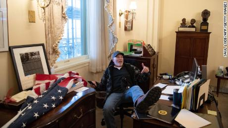 Officials say man seen in viral photograph at Nancy Pelosi's desk arrested