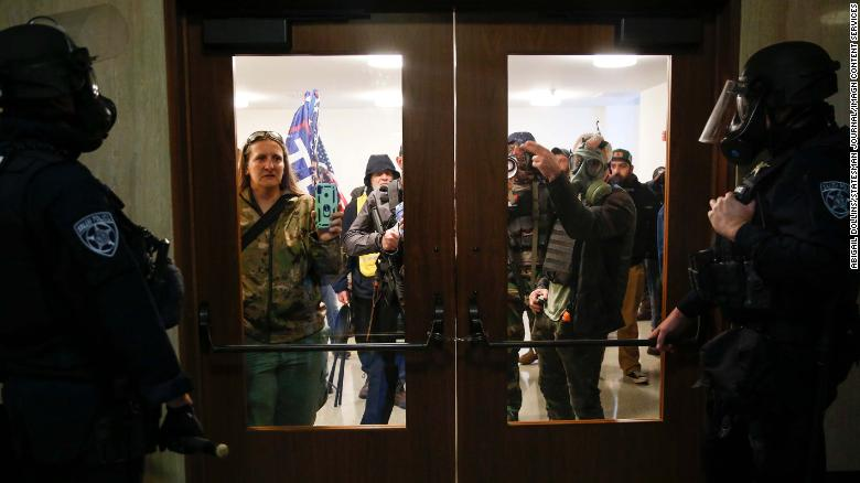 Officials claim Oregon legislator allowed protesters into state Capitol building during closed session