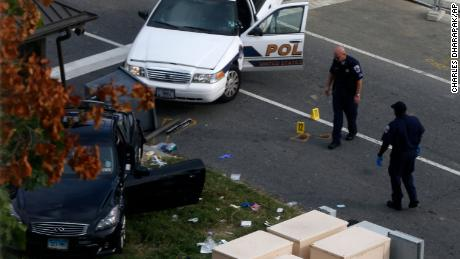 This file photo from October 3, 2013, shows the aftermath of a car chase on Capitol Hill in Washington in which police officers shot and kiiled Miriam Carey.