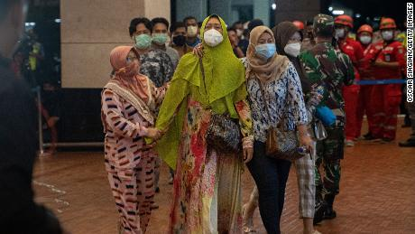 Relatives of Sriwijaya Air flight SJ 182 arrive at the crisis centre in Soekarno Hatta Airport, on January 9, 2021 in Jakarta.