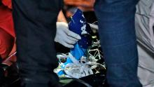 Rescuers examine debris found in the water off Java Island where a Sriwijaya Air passenger jet lost contact, at Tanjung Priok Port in Jakarta on January 10, 2021.