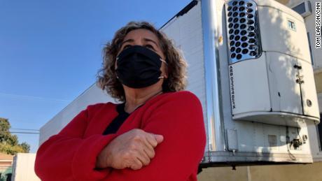 Magda Maldonado stands in front of a freezer trailer Friday outside her mortuary in Montebello, California.
