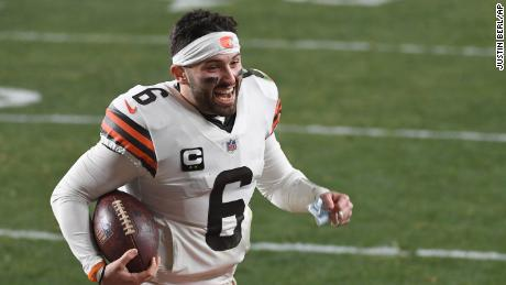 Mayfield celebrates as he runs off the field after defeating the Pittsburgh Steelers.