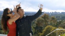 "Kelly Mi Li (left) and Kane Lim (right) are shown in a scene from ""Bling Empire."""