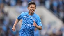Miura smiles while on the pitch for Yokohama FC against Vissel Kobe