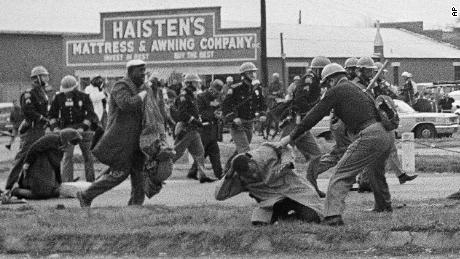 State troopers swing billy clubs to break up a voting rights march in Selma, Alabama, in 1965. Future congressman John Lewis, then chairman of the Student Nonviolent Coordinating Committee, is being beaten by a state trooper in the foreground.