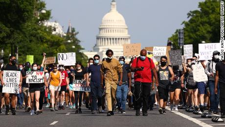 Demonstrators march down Pennsylvania Avenue during a protest against police brutality and the death of George Floyd, on June 3, 2020 in Washington.