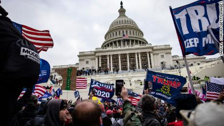 Rioters storm the US Capitol following a rally with President Donald Trump on January 6 in Washington.