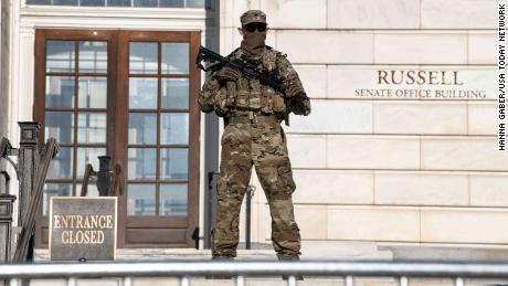 Armed National Guard troops are helping to secure government buildings and maintaining a perimeter around the US  Capitol.