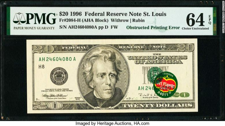 Auction bids are topping $  57,000 for a rare $  20 banknote with Del Monte sticker on it