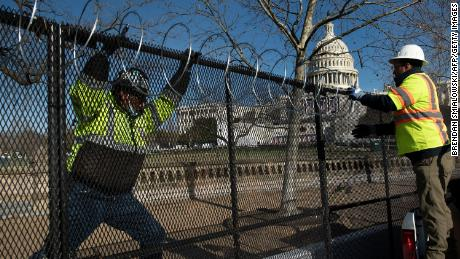 Razor wire is installed atop a security fence in preparation for next week's Presidential inauguration.