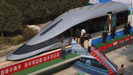 People visit a prototype magnetic levitation train developed with high-temperature superconducting (HTS) maglev technology at the launch ceremony in Chengdu, in southwestern China's Sichuan province on January 13, 2021. (Photo by STR / AFP) / China OUT (Photo by STR/AFP via Getty Images)