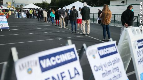 People wait in line to receive a Covid-19 vaccine at Disneyland Resort on January 13.
