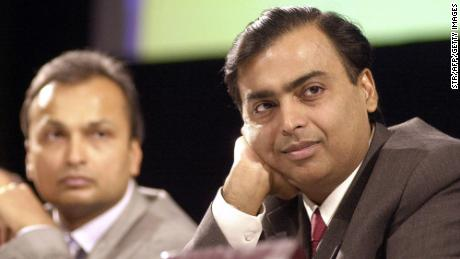 India's largest private sector company Reliance Industries Chairman and Managing Director Mukesh Ambani (R) along with then Vice Chairman Anil Ambani listen to shareholders opinions at the company's Annual General Meeting in Mumbai on June 24, 2004.