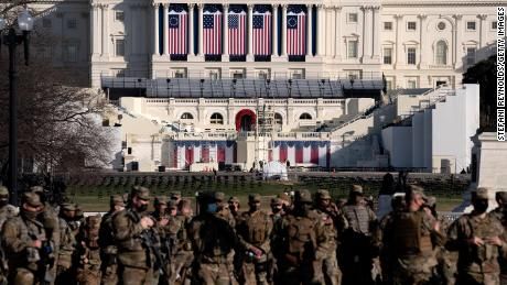 Members of the National Guard stand outside the  Capitol on January 14, 2021 in Washington, DC.