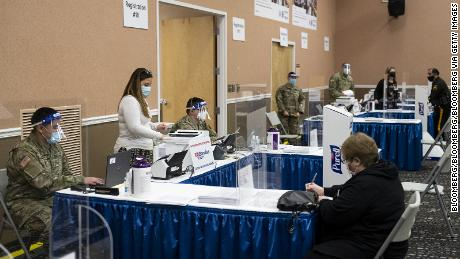 National Guard members assist with check-ins for vaccines in New Jersey.