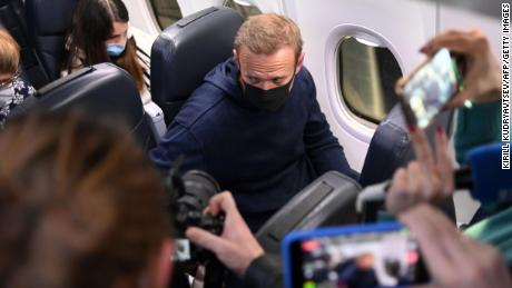 Russian opposition leader Alexei Navalny is seen in a Pobeda plane after it landed at Moscow's Sheremetyevo airport on January 17, 2021.