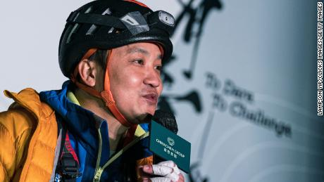 Lai Chi-wai talking to the press after climbing 250 米 (820 脚) up a skyscraper in Hong Kong on January 16.