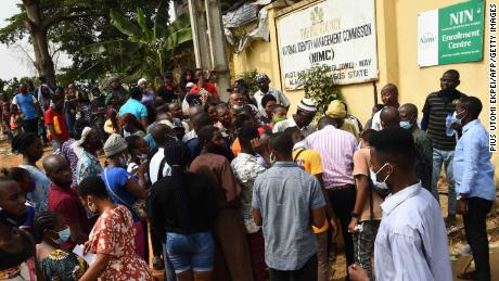 Applicants queue to get national identity numbers at the National Identity Management Commission office in Ikeja on December 30