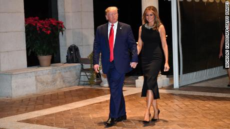 US President Donald Trump and First Lady Melania Trump arrive for a Christmas Eve dinner with his family at Mar-A-Lago in Palm Beach, Florida.