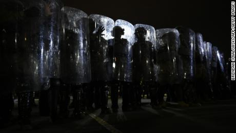 Riot police prepare to move demonstrators away from the US Capitol in Washington, DC, on January 6, 2021.