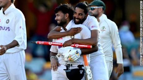 Pant (links) and Mohammed Siraj rejoice after India's record-breaking run chase.