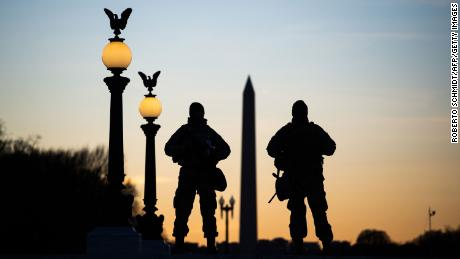 Nearly 5,000 National Guard troops to remain in Washington through mid-March due to concerns about QAnon chatter