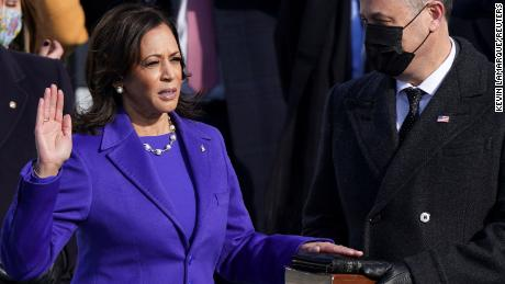 Kamala Harris is sworn in as Vice President as her spouse Doug Emhoff holds Bible.