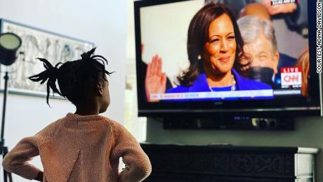 Adina Davidson's daughter, Aaliyah wathced closely as Harris was sworn in.