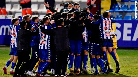 Alcoyano players celebrate after knocking out Real Madrid.