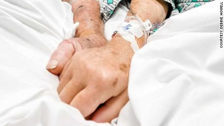 Photo taken at the hospital of Dick and Shirley holding hands before they died.