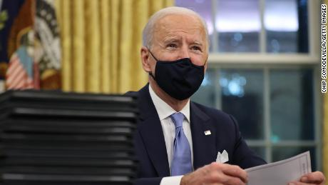 Biden signs orders to get checks and food aid to low-income Americans -- plus a federal pay raise