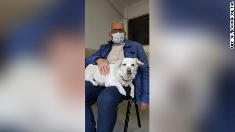 Boncuk, pictured here with owner Cemal Senturk, waited outside the hospital for six days.