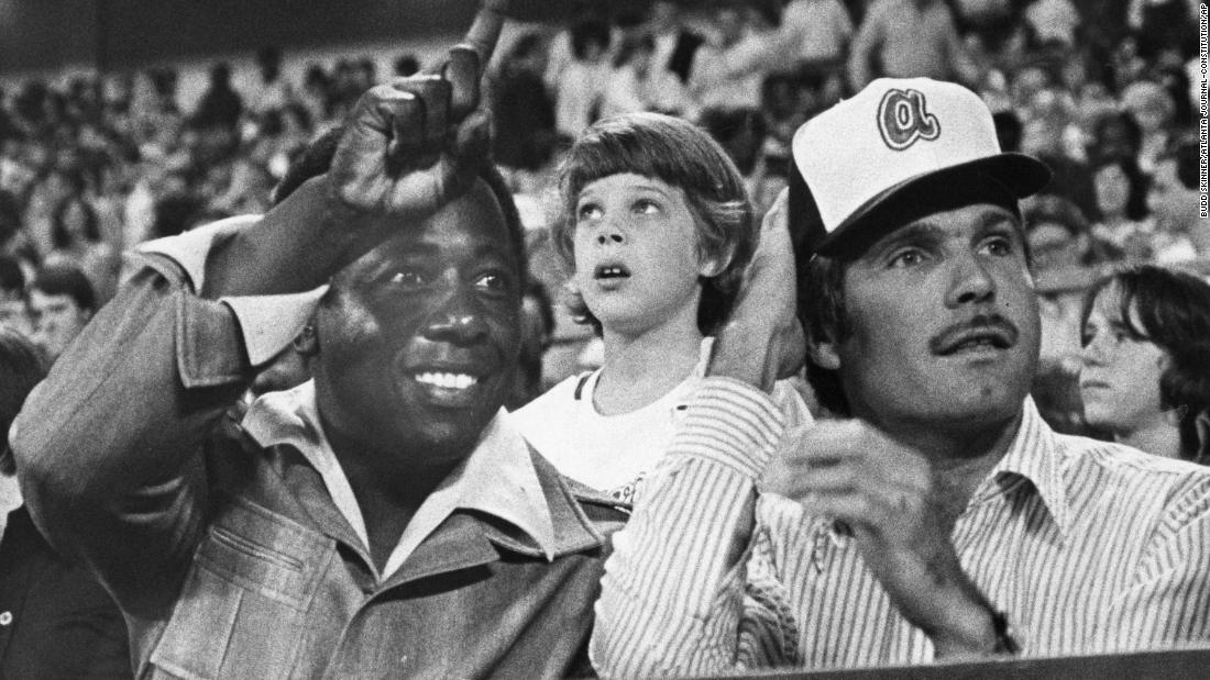 Aaron watches a Braves game with team owner Ted Turner in 1977.