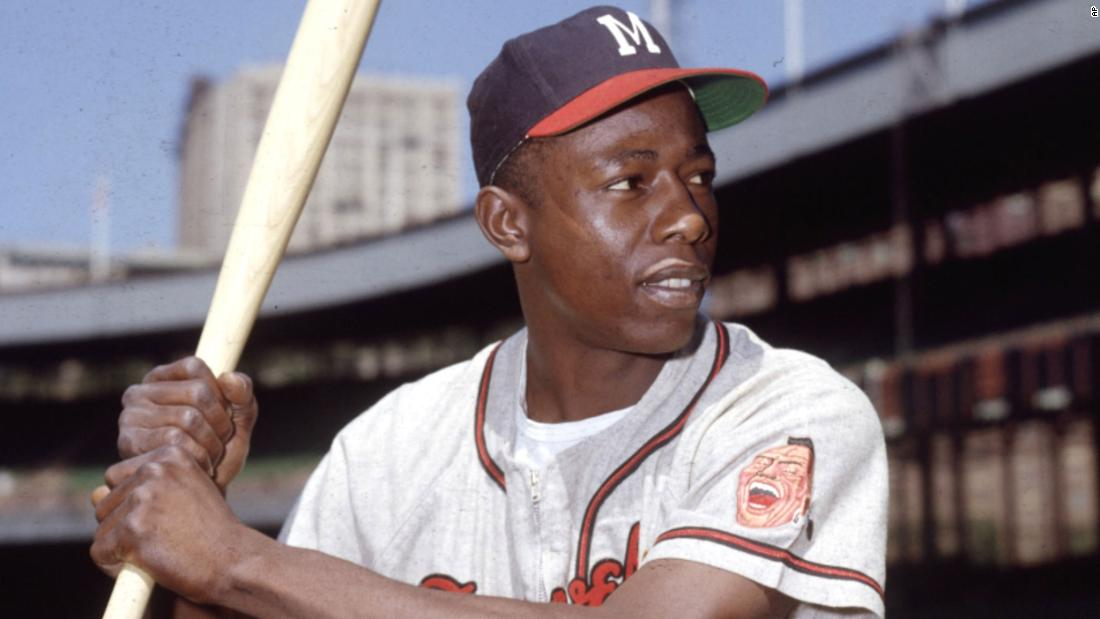 Hank Aaron poses for a photo during an exhibition game in 1954. It was his first season in the majors.