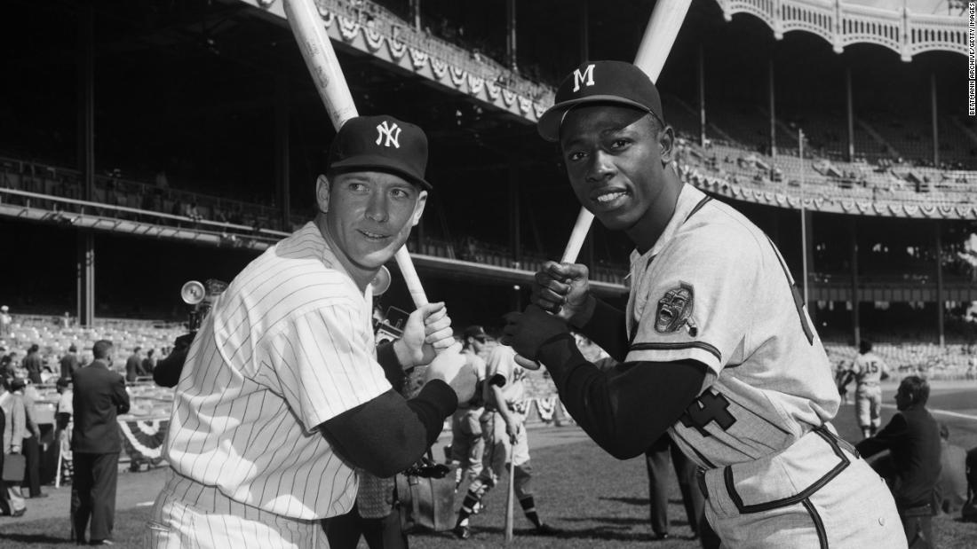 Aaron poses with New York Yankees slugger Mickey Mantle in 1957. That season, Aaron was named the National League's Most Valuable Player and his team defeated the Yankees to win the World Series.