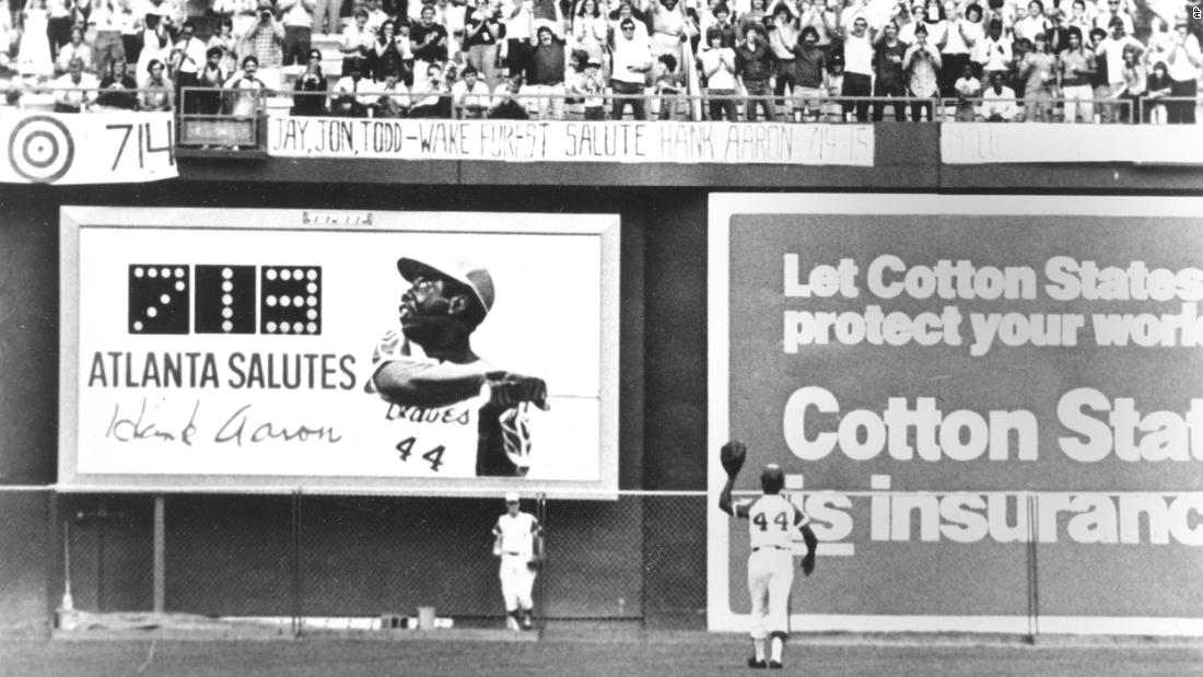 Aaron waves to Atlanta fans on the final day of the regular season in 1973. He ended the season with 713 home runs, one away from Babe Ruth's record.