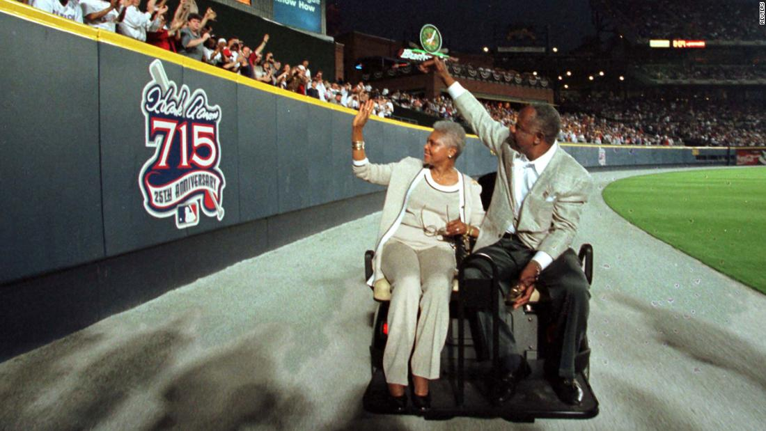 Aaron and his wife, Billye, wave to fans as they take a lap around Atlanta's Turner Field for the 25th anniversary of his 715th home run.