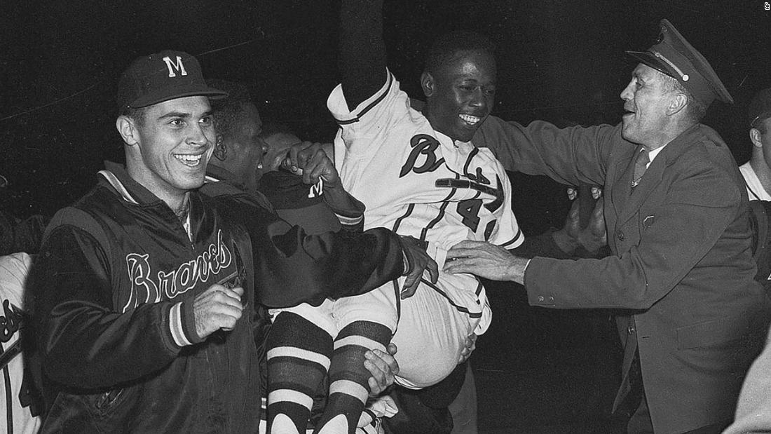 Aaron is carried off the field by his teammates after Milwaukee won the National League pennant in 1957.