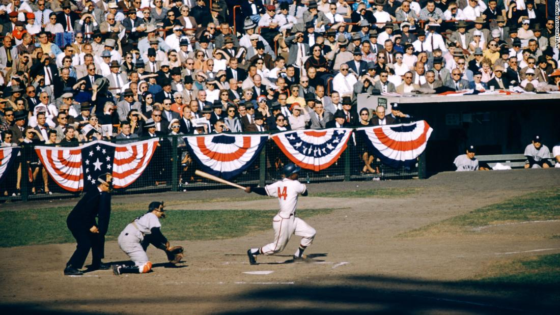 Aaron hits the ball during a World Series game in 1957.