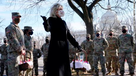 US First Lady Jill Biden surprises National Guard members outside the Capitol with chocolate chip cookies on January 22, 2021.