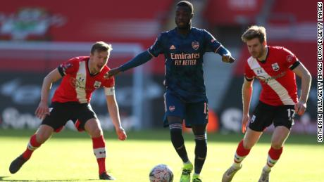 Arsenal's Nicolas Pepe is challenged by James Ward-Prowse (links) and Stuart Armstrong.
