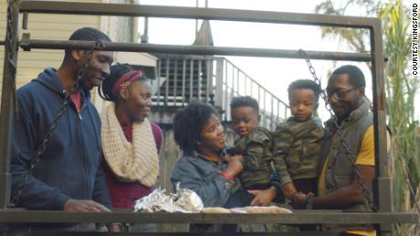 Barbecue historian Dr. Howard Conyers (left) cooks with his familiy in New Orleans on January 3, 2021.