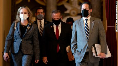 From left, House Impeachment Managers Rep. Madeleine Dean of Pennsylvania, Rep. Eric Swalwell of California, Rep. David Cicilline of Rhode Island, and Raskin wear protective masks while walking to the House Floor on January 13.