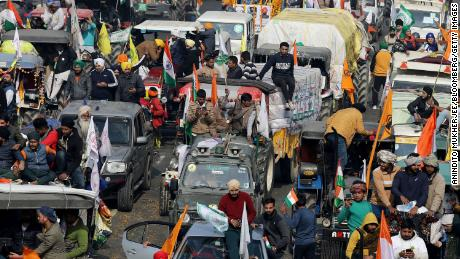 Farmers protest during a tractor rally near the Singhu border crossing in Delhi, India, on January 26, 2021.
